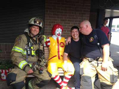 Firemen sitting at a McDonald's Restaurant