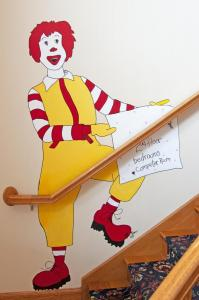 Ronald McDonald wall decoration by stairs